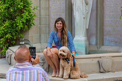 Jim Belluzi of Deerfield takes a photo of Bianca Kawecki of Palm Beach and her dog Bodhi at The Church of Bethesda-by-the-Sea before the annual Blessing of the Animals service on Sunday, October 6, 2019. [JOSEPH FORZANO/palmbeachpost.com]