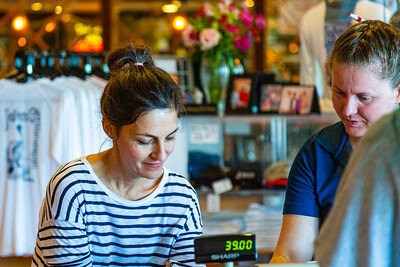 New owner, Doris Di Meglio and nine-year employee Andra Pettit at the cash register of John Gs' in Manalapan on Wednesday, October 9, 2019. Di Meglio and her husband Laurent, took over ownership of John G's this past Saturday. [JOSEPH FORZANO/palmbeachpost.com]