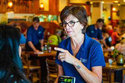 "Wendy Yarbrough, cashes out a patron at John G's on Wednesday, October 9, 2019. Wendy, and her brothers Keith and Jay Giragos are in the process of transitioning the restaurant to the new owners after 49 years of ownership. ""It's just time,"" Yarbrough said when asked why they were selling the restaurant. [JOSEPH FORZANO/palmbeachpost.com]"