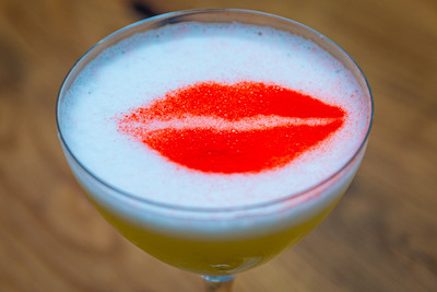 A Scusi white cranberry cosmo signature drink at Scusi Trattoria, located at 4520 PGA Blvd., Palm Beach Gardens, FL, on Thursday, November 21, 2019. [JOSEPH FORZANO/palmbeachpost.com]