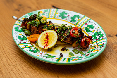 Spiced swordfish spiedini Sicilian style, with olives, tomato, capers, pine nuts, rosemary-polenta. Scusi Trattoria, located at 4520 PGA Blvd., Palm Beach Gardens, FL, on Thursday, November 21, 2019. [JOSEPH FORZANO/palmbeachpost.com]
