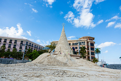 Sandi, the 35-foot tall, 700-ton Christmas Tree made of sand, being worked on by master artists on the Waterfront Great Lawn in West Palm Beach, FL, on Friday, November 22, 2019. [JOSEPH FORZANO/palmbeachpost.com]