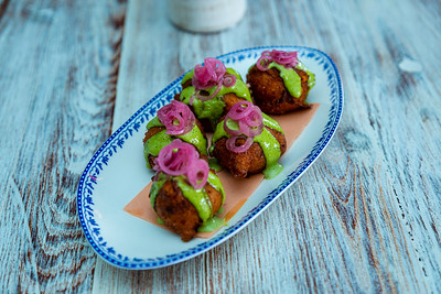 Hush puppies with green goddess dressing and pickled pearl onions, one of a number of snacks at Sassafras. Sassafras is located at 105 S Narcissus Ave., West Palm Beach, FL, on Friday, November 22, 2019. [JOSEPH FORZANO/palmbeachpost.com]