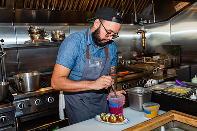 Edison Ramirez, chef at Sassafras, prepares hush puppies with green goddess dressing and pickled pearl onions on Friday, November 22, 2019. Sassafras is located at 105 S Narcissus Ave., West Palm Beach, FL,  [JOSEPH FORZANO/palmbeachpost.com]