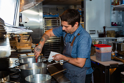 Daniel Orlando, chef at Sassafras, mixes ingredients in the kitchen on Friday, November 22, 2019. Sassafras is located at 105 S Narcissus Ave., West Palm Beach, FL,  [JOSEPH FORZANO/palmbeachpost.com]