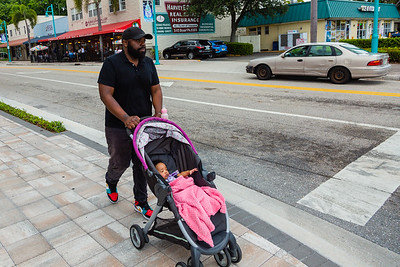 Carlton Williams pushes a stroller with his 5-month-old daughter Zuri Rae to the Ocean Food Mart, on Saturday, November 23, 2019. Williams was seriously injured in a hit-and-run crash near the intersection of Ocean Avenue and North Federal Highway in September 2019, less than a block from his apartment.  Two  employees from the store heard the accident and called 911 and stayed with Williams until paramedics arrived.[JOSEPH FORZANO/palmbeachpost.com]