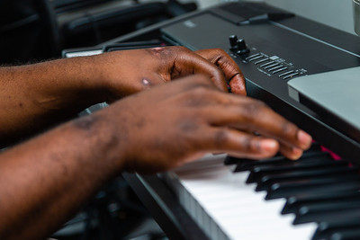 Carlton Williams sits at his keyboard and plays Christmas songs in his apartment in Boynton Beach on Saturday, November 23, 2019. Williams was seriously injured in a hit-and-run crash near the intersection of Ocean Avenue and North Federal Highway in September 2019, less than a block from his apartment.  The scars are still visible on his hands. [JOSEPH FORZANO/palmbeachpost.com]