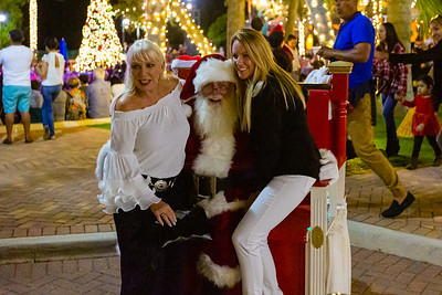 Two women pose with Santa Claus near the Harbourside Place Amphitheater.   Harbourside Place in Jupiter held their annual Tree Lighting Ceremony on Saturday, November 23, 2019.  [JOSEPH FORZANO/palmbeachpost.com]