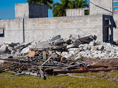 Demolition debris litters a lot in the Estates of Boynton Waters in Boynton Beach on Tuesday, December 3, 2019. Residents have been living along side unfinished buildings for more than 10 years. [JOSEPH FORZANO/palmbeachpost.com]