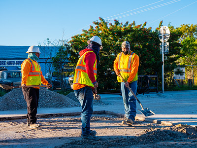 Workers for DP Development are bundled up for the early morning cold weather at Nottingham Blvd and Georgia Avenue in West Palm Beach on December 3, 2019. [JOSEPH FORZANO/palmbeachpost.com]