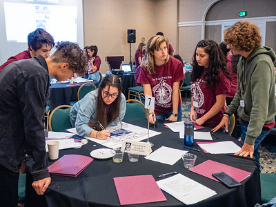 Students from Palm Beach Central High School design at front page at the High School Journalism Workshop, hosted by the Palm Beach Post at the Airport Hilton in West Palm Beach on Thursday, December 5, 2019. [JOSEPH FORZANO/palmbeachpost.com]