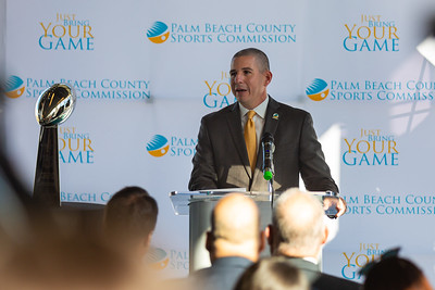 George Linley, Executive Director of the Palm Beach County Sports Commission speaks to the media about the impact of Super Bowl LIV in Palm Beach at a press conference at the Brightline station in downtown West Palm Beach on Monday, December 9, 2019. The Vince Lombardi trophy, which goes to the winning Super Bowl Team, sits on a pedestal to the left. [JOSEPH FORZANO/palmbeachpost.com]