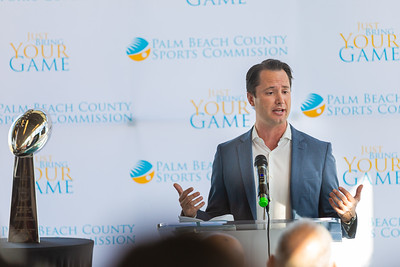 Ben Porritt, Senior Vice President of Corporate Affairs for Brightline, speaks to the media about the impact of Super Bowl LIV in Palm Beach at a press conference at the Brightline station in downtown West Palm Beach on Monday, December 9, 2019. The Vince Lombardi trophy, which goes to the winning Super Bowl Team, sits on a pedestal to the left. [JOSEPH FORZANO/palmbeachpost.com]