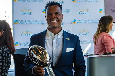 Rashad D. Thomas, Vice President of Business Connect and Community Outreach for the Miami Super Bowl Host Committee hold the Vince Lombardi Trophy after a press conference at the Brightline station in downtown West Palm Beach on Monday, December 9, 2019. [JOSEPH FORZANO/palmbeachpost.com]