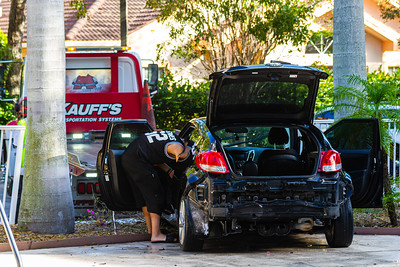 A man backed his car into the pool at the Holiday Inn Express at the Metrocentre in West Palm Beach on Friday, January 4, 2020.  [JOSEPH FORZANO/palmbeachpost.com]