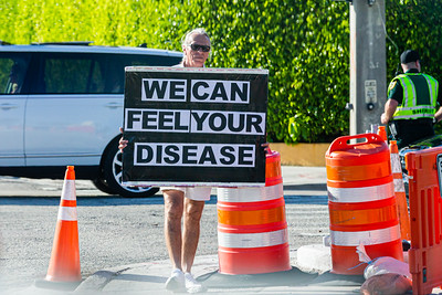 A Trump protester with a sign stands along Southern Blvd. on Saturday, January 04, 2020. [JOSEPH FORZANO/palmbeachpost.com]