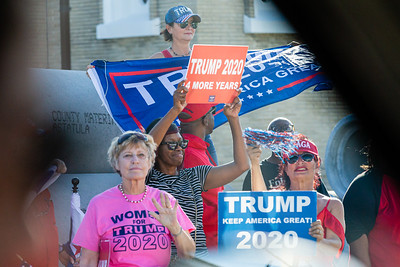 Trump supporters along Southern Blvd. gather in the hopes of seeing the President on Saturday, January 04, 2020. [JOSEPH FORZANO/palmbeachpost.com]