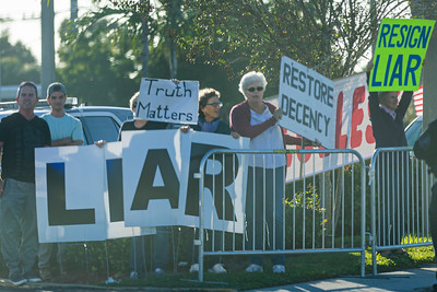 Trump protesters watch the Presidential motorcade drive by on Southern Blvd., in West Palm Beach on Sunday, January 5, 2020.  [JOSEPH FORZANO/palmbeachpost.com]