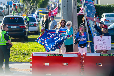 Supporters of President Donald J. Trump wave flags as the Presidential motorcade passes by on Southern Blvd., on Sunday, January 05, 2020. [JOSEPH FORZANO/palmbeachpost.com]