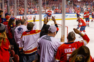 Panther fans crowd the glass to watch the pregame warmup skate at the BB&T Center on Thursday, January 9, 2020, where the Florida Panther hosted the Vancouver Canucks. The Panthers would go on to beat the Canucks 5-2.  [JOSEPH FORZANO/palmbeachpost.com]