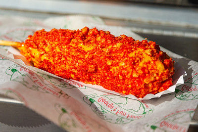 A corn dog covered in Cheetos from George's Fun Foods at the South Florida Fair in West Palm Beach on Monday, January 20, 2020. [JOSEPH FORZANO/palmbeachpost.com]