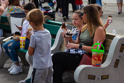 South Florida Fair goers enjoying snacks from one of the many food booths at the South Florida Fair in West Palm Beach on Monday, January 20, 2020. [JOSEPH FORZANO/palmbeachpost.com]