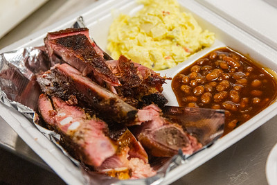 A rib dinner with sides of potato salad and baked beans at McCray's Backyard Bar-B-Q & Seafood in Mangonia Park on Thursday, January 23, 2020. [JOSEPH FORZANO/palmbeachpost.com]