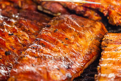 Racks of ribs on one of the open pit wood grills at McCray's Backyard Bar-B-Q & Seafood in Mangonia Park on Thursday, January 23, 2020. [JOSEPH FORZANO/palmbeachpost.com]