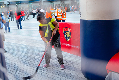 A woman tries her hand at the sharpshooter game on the Jet Blue Tarmac at the BB&T Center in Sunrise, FL on Thursday, February 13, 2020 where the Florida Panthers hosted the Philadelphia Flyers. The Flyers went on to beat the Panthers 5-2. [JOSEPH FORZANO/palmbeachpost.com]
