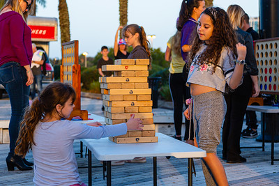 Two kids play a game of Jenga on the Jet Blue Tarmac at the BB&T Center in Sunrise, FL on Thursday, February 13, 2020 where the Florida Panthers hosted the Philadelphia Flyers. The Flyers went on to beat the Panthers 5-2. [JOSEPH FORZANO/palmbeachpost.com]