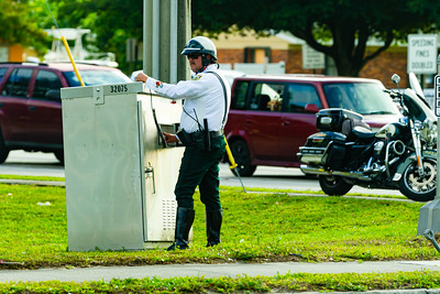 A PBSO Officer controls the traffic lights to allow President Trump's motorcade to pass an intersection in West Palm Beach, FL on Saturday, February 15, 2020. [JOSEPH FORZANO/palmbeachpost.com]