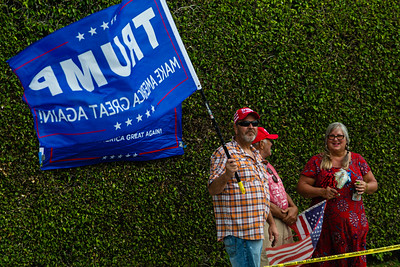 Supporters of President Trump wave a flag and cheer as the motorcade drives by on Southern Blvd. in West Palm Beach, FL on Sunday, February 16, 2020. [JOSEPH FORZANO/palmbeachpost.com]
