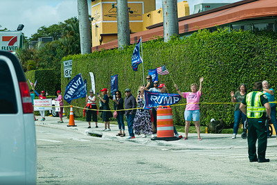 Supporters of President Trump wave a flags and cheer as the motorcade drives by on Southern Blvd. in West Palm Beach, FL on Sunday, February 16, 2020. [JOSEPH FORZANO/palmbeachpost.com]