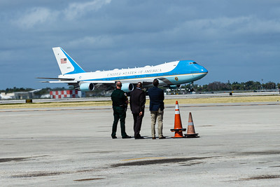 Law enforcement officers watch as Air Force One lifts off from Palm Beach International Airport on Sunday, February 16, 2020. [JOSEPH FORZANO/palmbeachpost.com]
