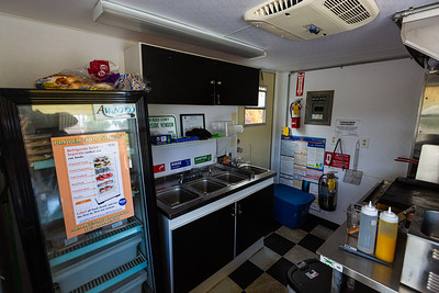The kitchen of the Podunk Eats food truck, located on Ellison Wilson Road, across from Bert Wilders Park in Juno Beach, FL on Tuesday, February 25, 2020. The Podunk Eats food truck, owned by Angela and Dario Grear, specializes in southern comfrort food. [JOSEPH FORZANO/palmbeachpost.com]