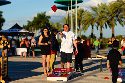 Fans play a game of cornhole on the Jet Blue Tarmac at the BB&T Center in Sunrise, FL on Thursday, March 5, 2020 where the Florida Panthers hosted the Boston Bruins. The Bruins went on to beat the Panthers 2-1 in overtime. [JOSEPH FORZANO/palmbeachpost.com]