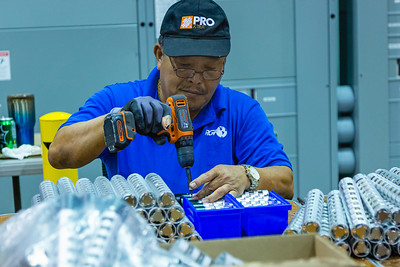 A technician at RGF Environmental Group assembles a part of the Reme-Halo residential air purifier at the RGF manufacturing plant in Riviera Beach on Friday, March 27, 2020. Since the global coronavirus outbreak, their sales are up 500 percent, and they have added a third shift in their Riviera Beach  factory. [JOSEPH FORZANO/palmbeachpost.com]