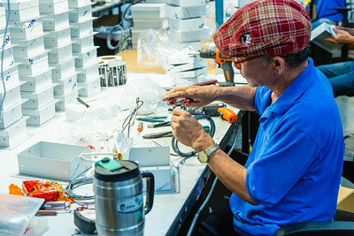 A technician at RGF Environmental Group wires a ballast for the Microcon Mobile Air Purifier at the RGF manufacturing plant in Riviera Beach on Friday, March 27, 2020. Since the global coronavirus outbreak, their sales are up 500 percent, and they have added a third shift in their Riviera Beach  factory. [JOSEPH FORZANO/palmbeachpost.com]