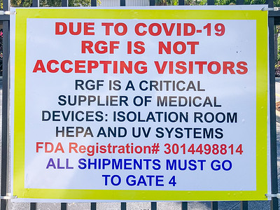 A warning sign on the gate of RGF Environmental Group in Riviera Beach on Friday, March 27, 2020. Since the global coronavirus outbreak, their sales are up 500 percent, and they have added a third shift in their Riviera Beach  factory. [JOSEPH FORZANO/palmbeachpost.com]