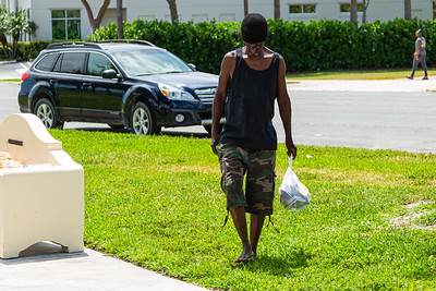 A homeless man returns to his sleeping place in Currie Park after getting his food items from The Lord's Place on Tuesday, March 31, 2020. The Lord's Place is still delivering food two days a week during the coronavirus pandemic. [JOSEPH FORZANO/palmbeachpost.com]