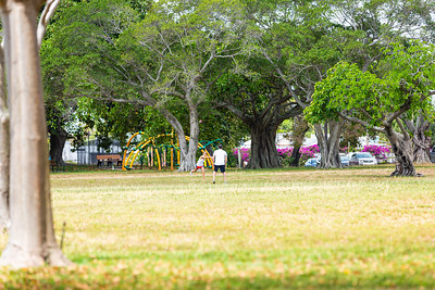 A couple tosses a football in an otherwise empty Phipps park in West Palm Beach on Tuesday, March 31, 2020. Phipps Park is closed until further notice due to the coronavirus pandemic. [JOSEPH FORZANO/palmbeachpost.com]