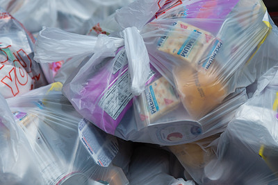 Plastic bags filled with cereal, soup, granola bars, trail mix, fruit cups, tuna and mayonnaise are being given to the homeless of West Palm Beach by The Lord's Place on Tuesday, March 31, 2020. The Lord's Place is still delivering food two days a week during the coronavirus pandemic. [JOSEPH FORZANO/palmbeachpost.com]