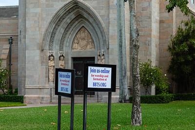 Signs in front of Bethesda-by-the-Sea ask parishioners of the church to join online services, on Tuesday, March 13, 2020. The church was originally scheduled to open on March 27, but is still closed due to the coronavirus pandemic. [JOSEPH FORZANO/palmbeachpost.com]