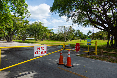 The gates to Dreher Park are closed and locked on Tuesday, March 31, 2020. The park is closed due to the coronavirus pandemic. [JOSEPH FORZANO/palmbeachpost.com]