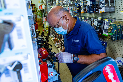 Diego Perez cuts a key for a customer at George's Hardware on Dixie Highway in West Palm Beach on Thursday, April 2, 2020. George's Hardware remains open and is considered an essential business during the coronavirus pandemic. [JOSEPH FORZANO/palmbeachpost.com]