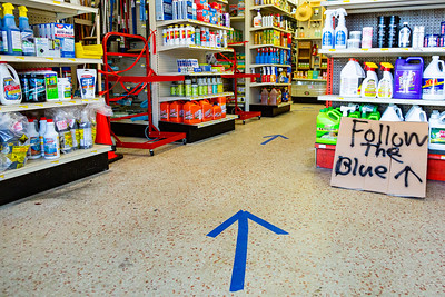 George's Hardware in West Palm Beach has arrows taped to the floor, directing customer how to get around the store on Thursday, April 2, 2020. George's Hardware remains open and is considered an essential business during the coronavirus pandemic. [JOSEPH FORZANO/palmbeachpost.com]