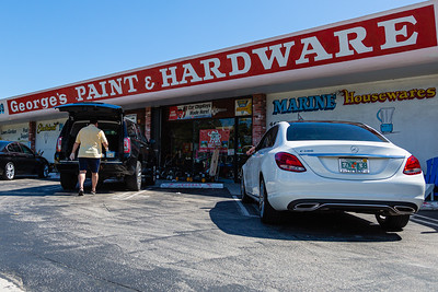 A customer loads items in the back of his SUV in front of George's Hardware in West Palm Beach on Thursday, April 2, 2020. George's Hardware remains open and is considered an essential business during the coronavirus pandemic. [JOSEPH FORZANO/palmbeachpost.com]
