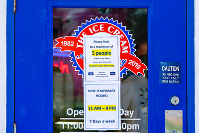 A sign on the door of the Ice Cream Club in Manalapan lets customers know that only 5 people are allowed in the shop at a time and they must practice social distancing during the coronavirus pandemic, Thursday, April 2, 2020. [JOSEPH FORZANO/palmbeachpost.com]