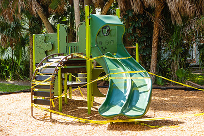 The jungle gym at George Petty Park on Washington Road in West Palm Beach is wrapped in caution tape. The playground equipment is off-limits due to the coronavirus pandemic. [JOSEPH FORZANO/palmbeachpost.com]