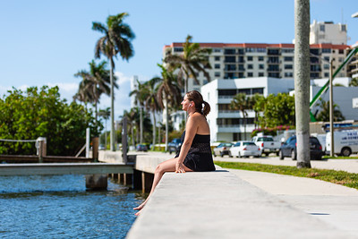 Kayla Lawhead of West Palm Beach sits on the seawall getting some sun on S. Flagler Drive in West Palm Beach, Tuesday, April 7, 2020. [JOSEPH FORZANO/palmbeachpost.com]
